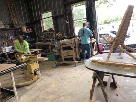 Workshop with men using equipment