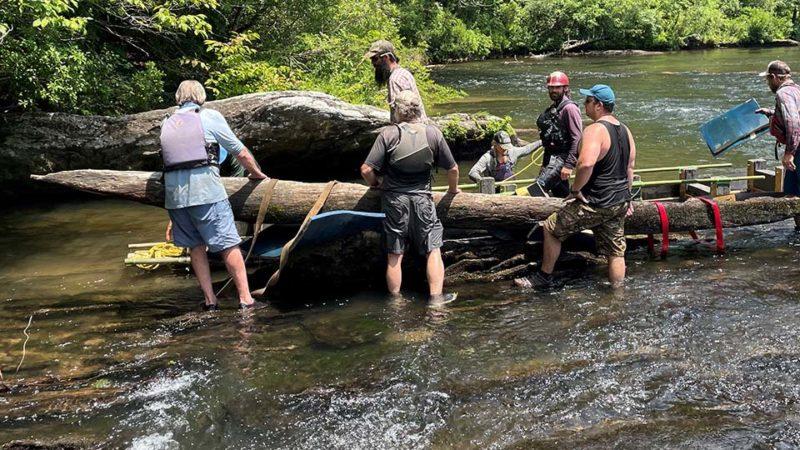 hand-hewn canoe
